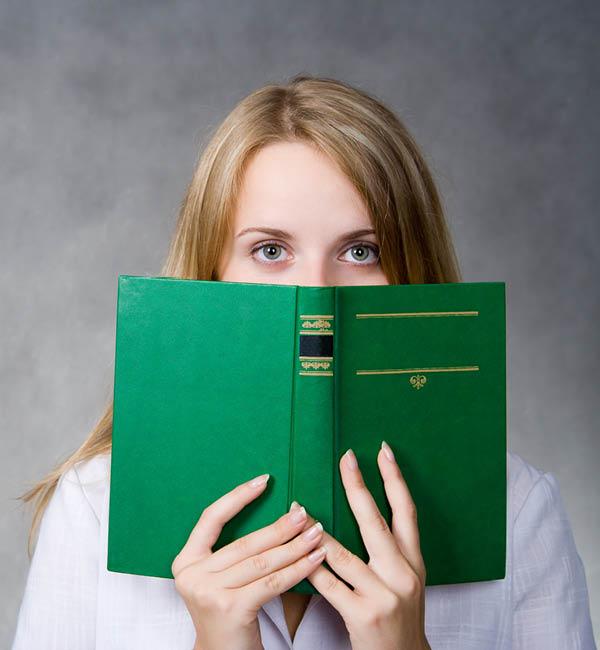 Woman reading book secretly