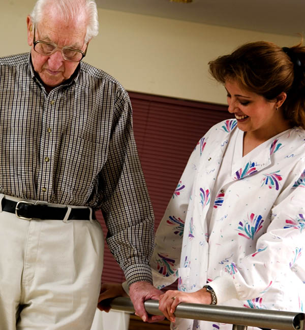 Therapist helping patient at Infinity Rehab