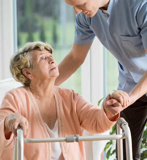 Physical therapist helping patient for Avamere and Infinity Rehab