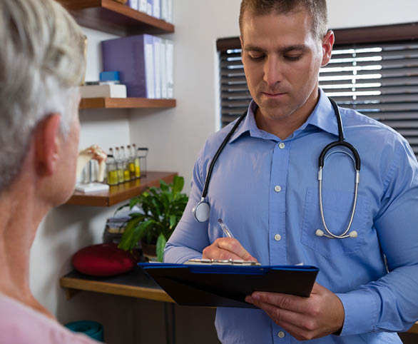 Therapist documenting conversation with patient for Infinity Rehab