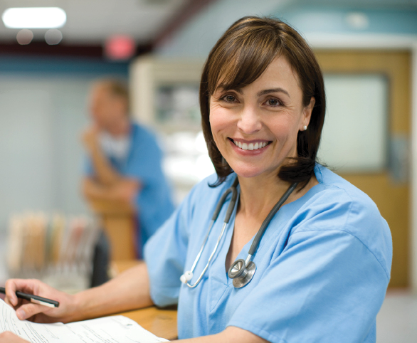 Nurse with chart smiling