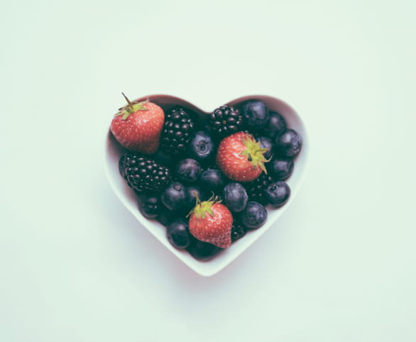 Heart-shaped bowl with fruit
