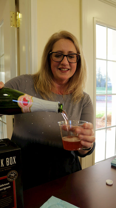 Pouring sparkling cider as Avamere at St. Helens celebrates their 20th Anniversary