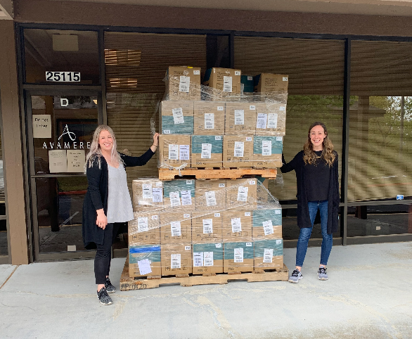 Kelsey Margheim and Maggie Hilty ship PPE for Avamere to communities in need during COVID-19