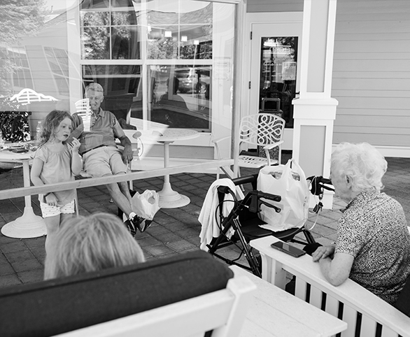 Senior residents and family visiting outside during COVID-19