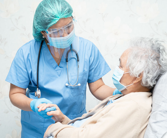 Nurse with senior resident during COVID-19
